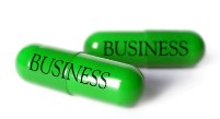 Graphic of a pill capsule that says business on the side